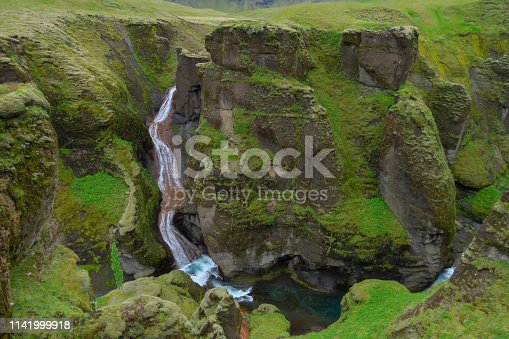 Waterfall and river at the end of Fjadrargljufur Canyon, Kirkjubæjarklaustur, Iceland, Europe