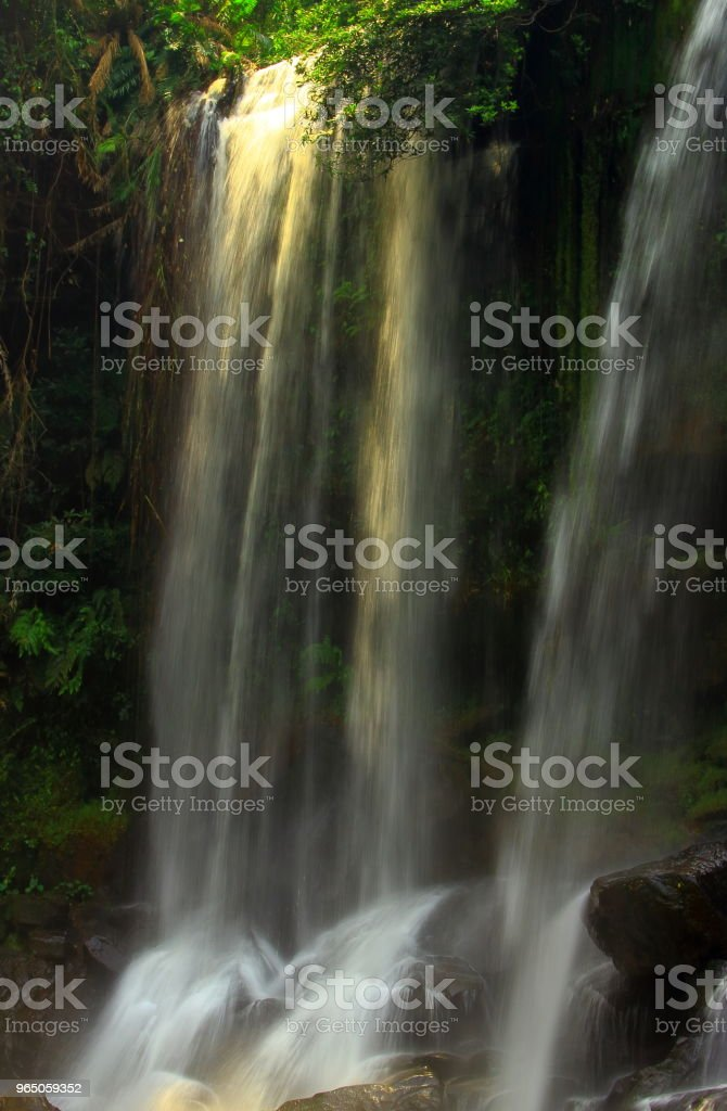 Majestic waterfall in jungle Cambodia royalty-free stock photo
