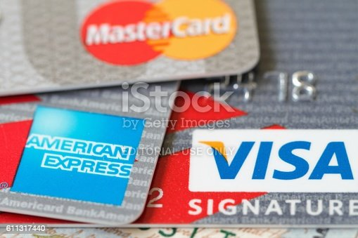 West Palm Beach, USA - September 1, 2016: Closeup detail of three major credit cards:  VISA, Master Card, and American Express.