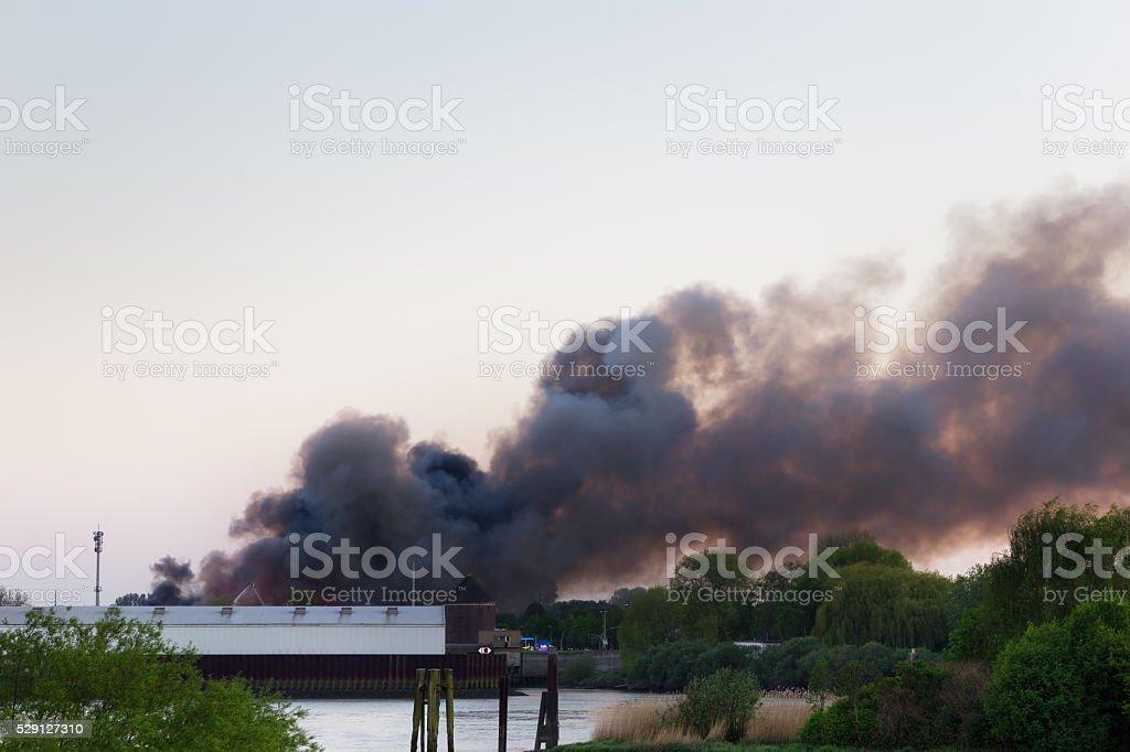 Major fire with dark smoke stock photo