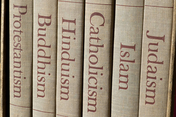 major world religions Book spines listing major world religions - Judaism, Islam, Catholicism, Hinduism, Buddhism and Protestantism. religion stock pictures, royalty-free photos & images