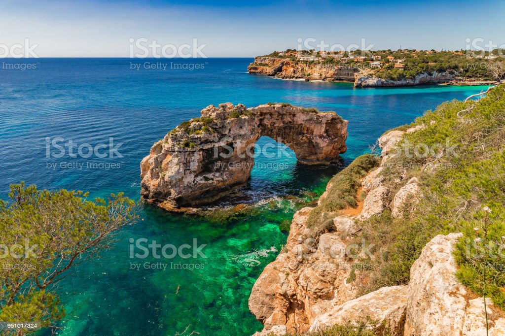 Beautiful view of the natural landmark Es Pontas, rock arch on...