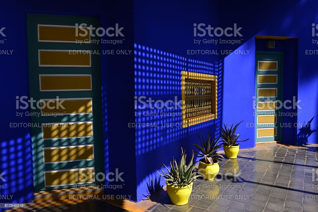 Jardin Majorelle, Marrakech, Morocco, Africa. Marrakech, Morocco, - February 21, 2016: The famous blue house of Jardin Majorelle. Built originally by Jacque Majorelle 1931 who died 1962. The building left in ruin and nearly demolished by developers and was saved in 1980 by Pierre Berge and Yves Saint Laurent. The premises have a gallery,museum and gardens where proceeds from tourism go to local and worldwide causes. Africa Stock Photo