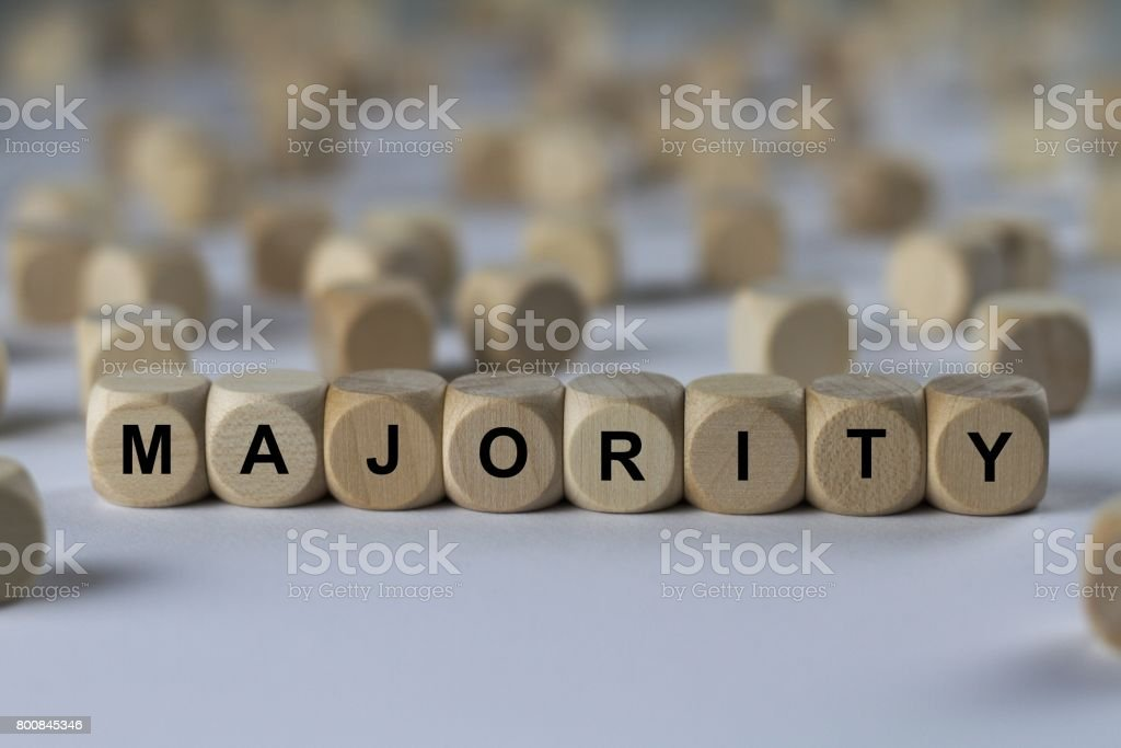 majority - cube with letters, sign with wooden cubes stock photo
