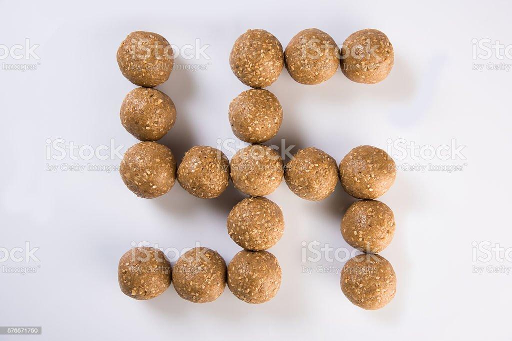 Makar Sankranti sweet tilgul or til gul laddu or laddoo stock photo