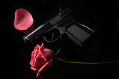 Makarov pistol and a red rose