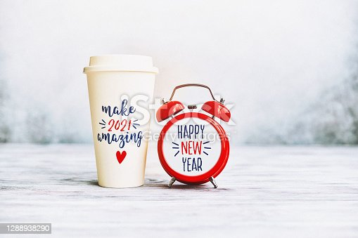 Make 2021 Amazing. Happy New Year Background with Clock and Coffee Cup