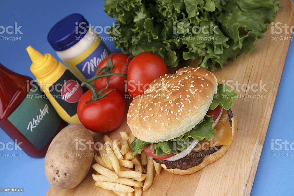 Make a Delicious Cheeseburger royalty-free stock photo