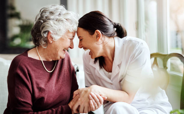 Make a difference in someone's life by making them smile Cropped shot of seniors enjoying life in a retirement home face to face stock pictures, royalty-free photos & images