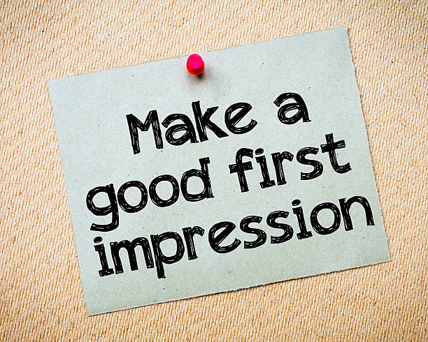 Make a first good impression Make a first good impression Message. Recycled paper note pinned on cork board. Concept Image imitation stock pictures, royalty-free photos & images