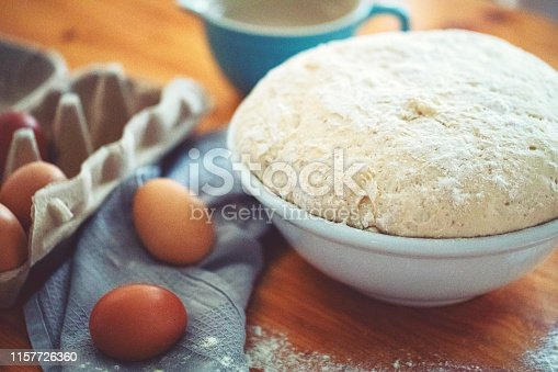 istock Make a fresh yeast dough in the kitchen 1157726360