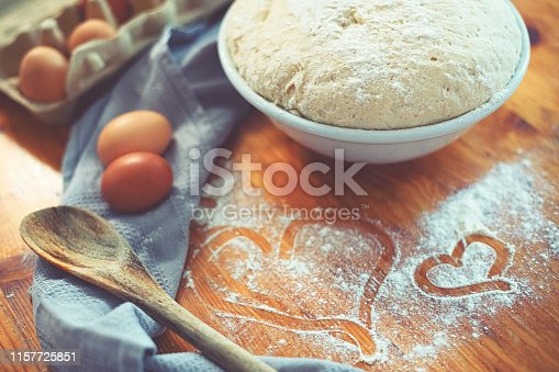 istock Make a fresh yeast dough in the kitchen with love 1157725851