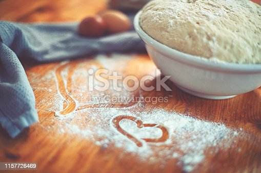 istock Make a fresh yeast dough in the kitchen with love 1157726469