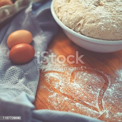istock Make a fresh yeast dough in the kitchen with love 1157726590