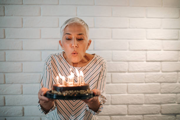 make a wish! - blowing stock photos and pictures