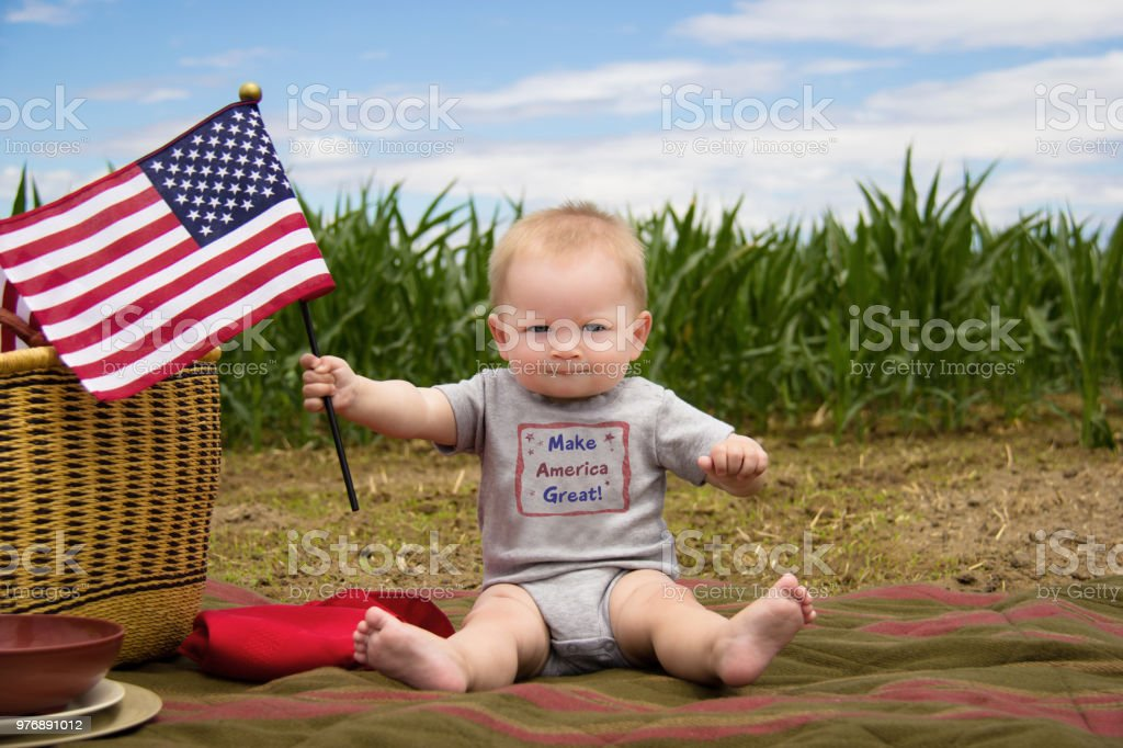 Make America Great baby boy with American Flag stock photo
