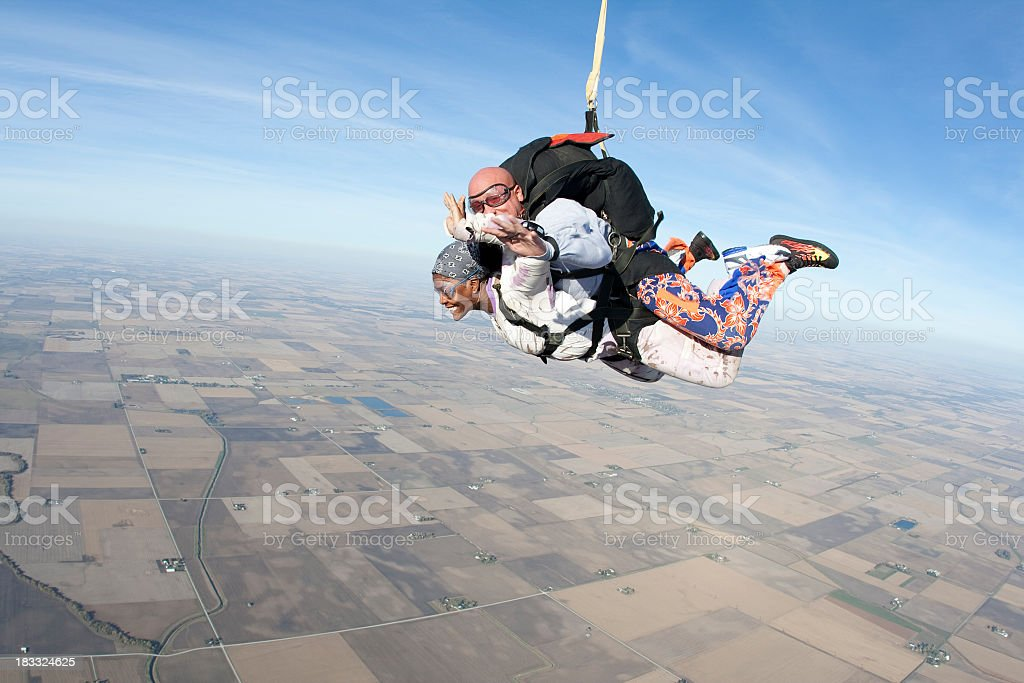 Make and female tandem skydivers in the sky royalty-free stock photo
