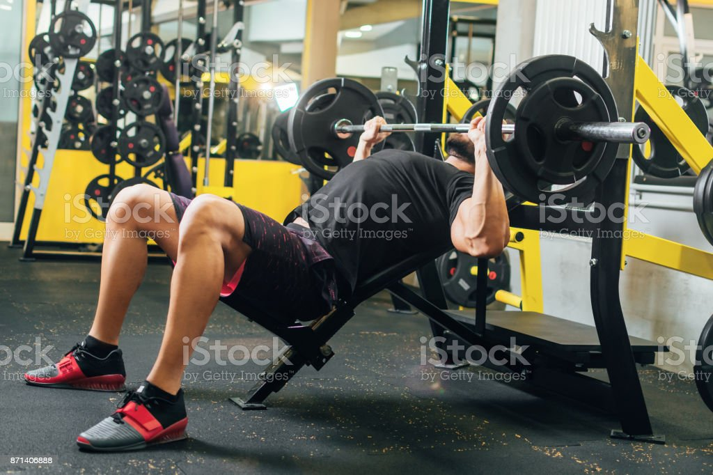 Muscular man workout on the bench press