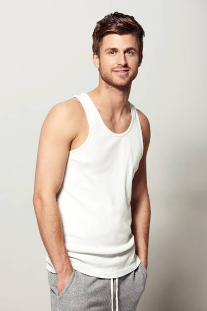 I make everything look cool! Studio portrait of a casually dressed young man smiling at the camera tank top stock pictures, royalty-free photos & images