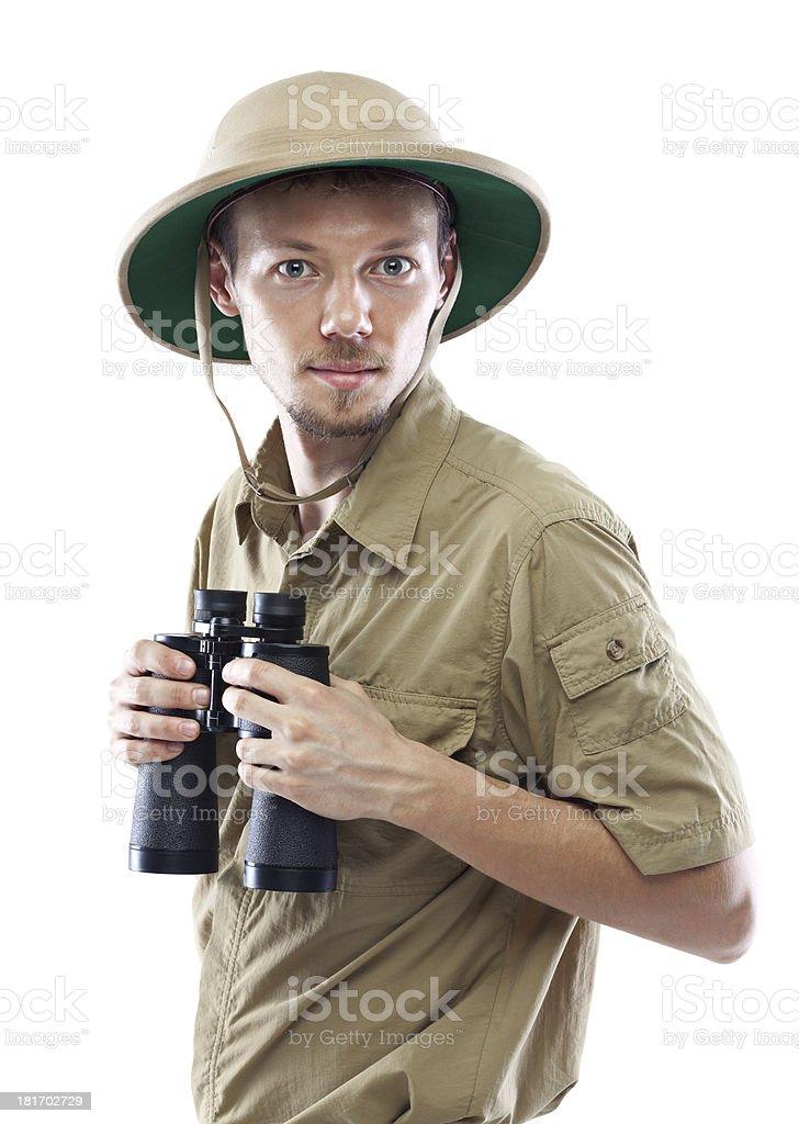 Make explored in cargo shirt and hat holding binoculars stock photo