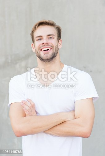 Make it possible. summer male fashion. his charisma. man unshaven face stylish hairstyle. Bearded man casual style. portrait of male attractiveness. young sexy guy gray background. cheerful macho man.