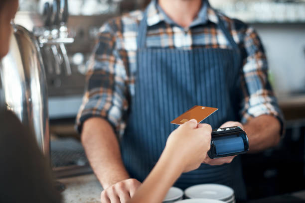 make sure you take a tip - paying with card contactless imagens e fotografias de stock
