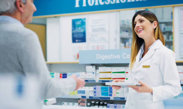 Make sure you use them appropriately for the best results Shot of a pharmacist assisting a customer in a chemist appropriately stock pictures, royalty-free photos & images