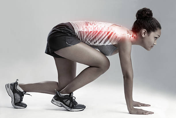 Make the pain drive you Full length studio shot of a female runner with cgi joint inflammation spine body part stock pictures, royalty-free photos & images