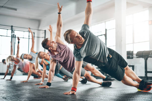 Make time for it Shot of a fitness group working out at the gym exercise class stock pictures, royalty-free photos & images