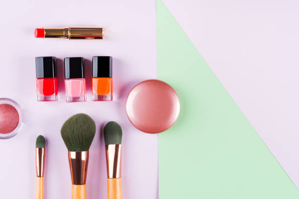 Make up accessories on purple and green. Flat lay stock photo