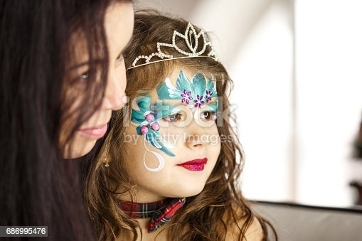 istock Make up artist and a beautiful little girl 686995476