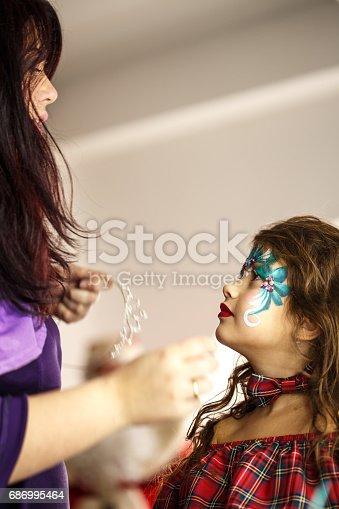 istock Make up artist at work 686995464