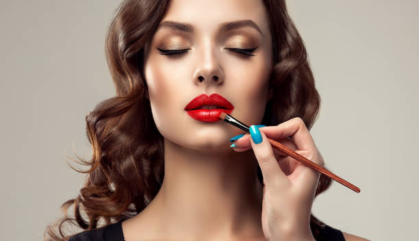 make up artist is working with face of gorgeous model. cosmetic, manicure and make up. - makeup zdjęcia i obrazy z banku zdjęć