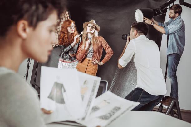 Make up artist preparing model stock photo