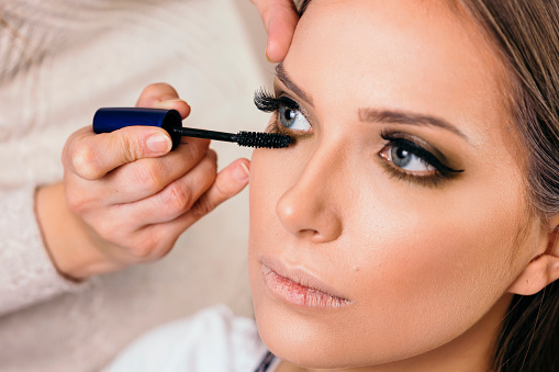 Make Up Artist Putting Mascara On Eyelashes Stock Photo - Download ...