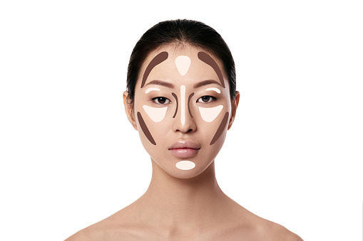 Contouring. Make up asian woman face on white background. Contour and highlight makeup. Professional face make-up sample