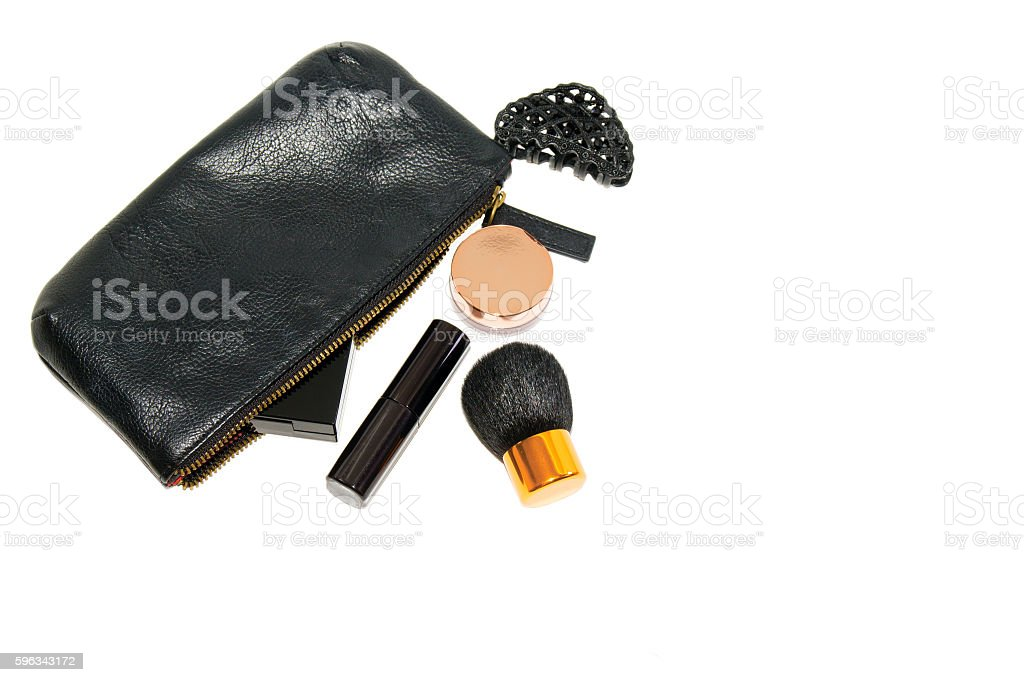 make up bag with cosmetics and brush on white background royalty-free stock photo