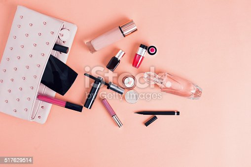istock Make up bag with cosmetics isolated on pink background 517629514