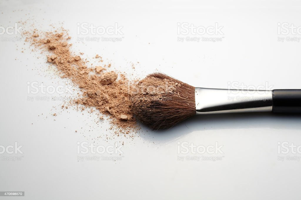 Make up brush with loose powder on white background. stock photo