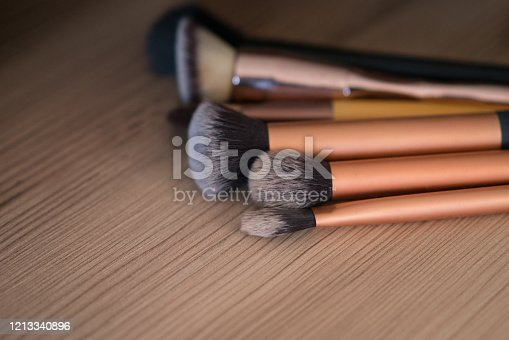 istock Make up brushes on the wood table 1213340896
