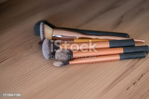 istock Make up brushes on the wood table 1213341153