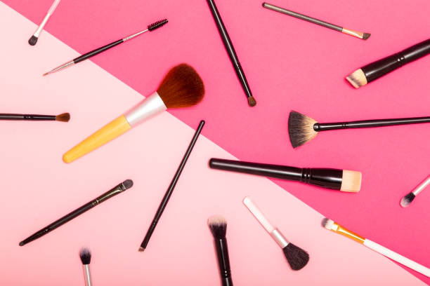 Make up brushes set Flat lay of professional make up brushes set isolated on pink background make up brush stock pictures, royalty-free photos & images