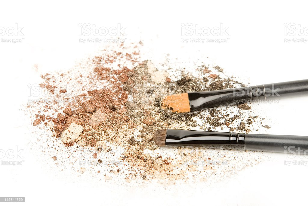 Make up brushes with brown eyeshadow. royalty-free stock photo
