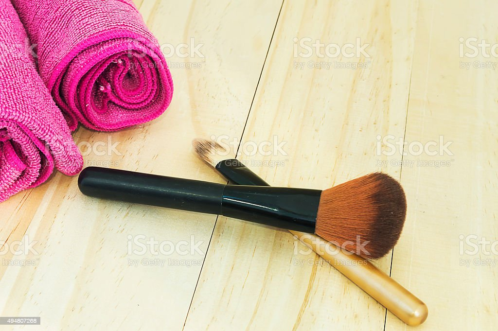Make up brushes with towl and wood background stock photo