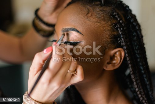 istock Make up of american black model. Preparing to shooting. Closed 624904042