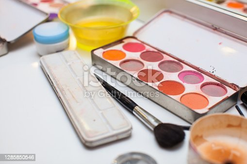 Make up palette and materials on a white table