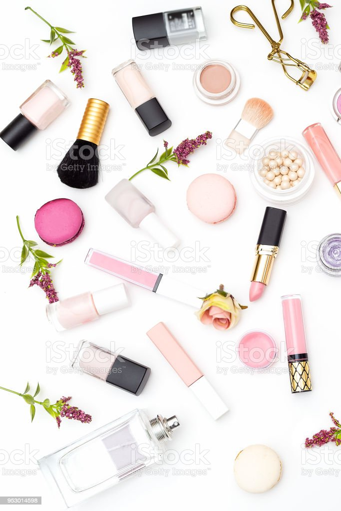 Make up products and flowers on white background. Vertical photo stock photo