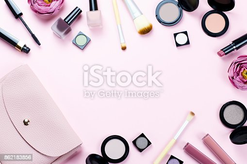 istock Make up products frame on a pastel pink background 862183856