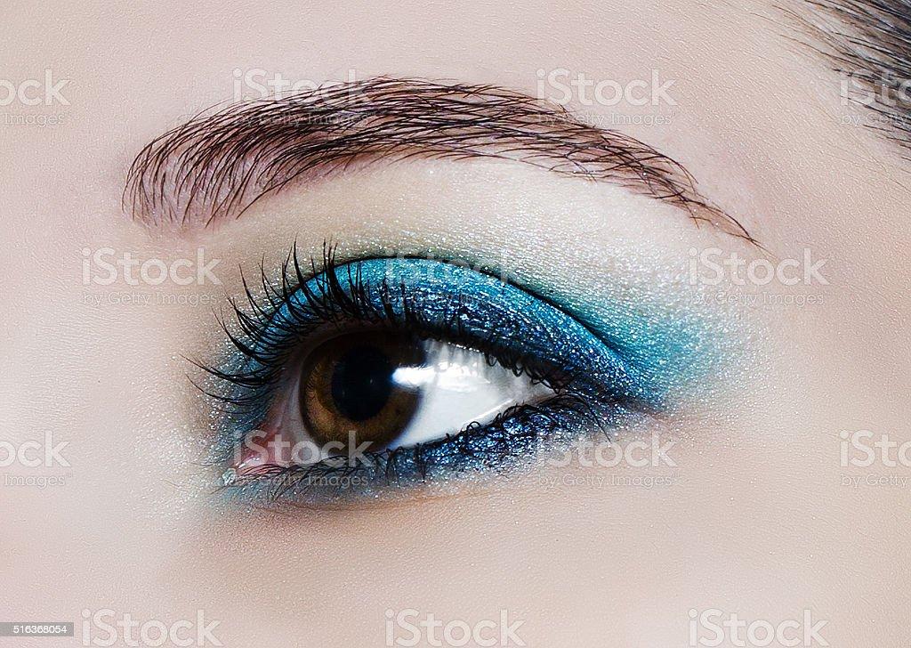 Make up trend: blue shiny eyeshadows. stock photo