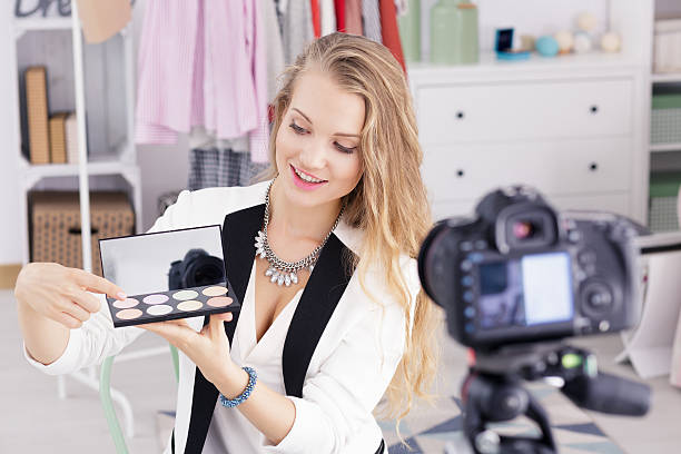 Make up vlogger recording broadcast stock photo